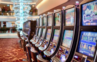 Photo by Stokpic of a row of Poker Machines.