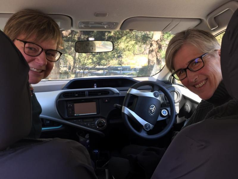 Dr Sue Mallett and Women's Health Tasmania CEO Jo Flanagan in the trusty Women's Health Tasmania work car/recording studio last year (such pre-social distancing proximity!)